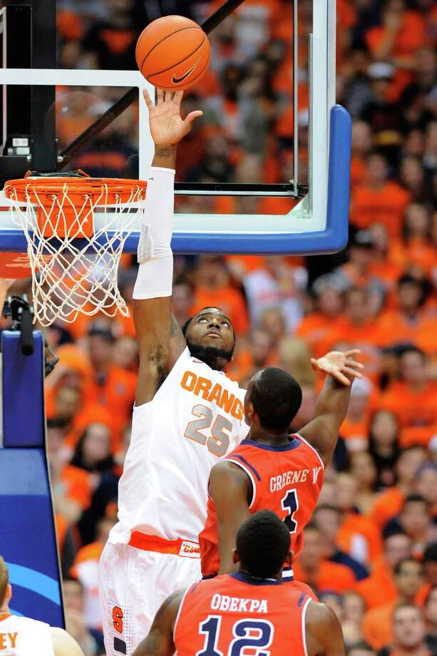 SYRACUSE, NY - DECEMBER 06:  Rakeem Christmas #25 of the Syracuse Orange blocks a shot by Phil Greene IV #1 of the St. John's Red Storm during the first half at the Carrier Dome on December 6, 2014 in Syracuse, New York.  (Photo by Rich Barnes/Getty Images) ORG XMIT: 521825419 Photo: Rich Barnes / 2014 Getty Images