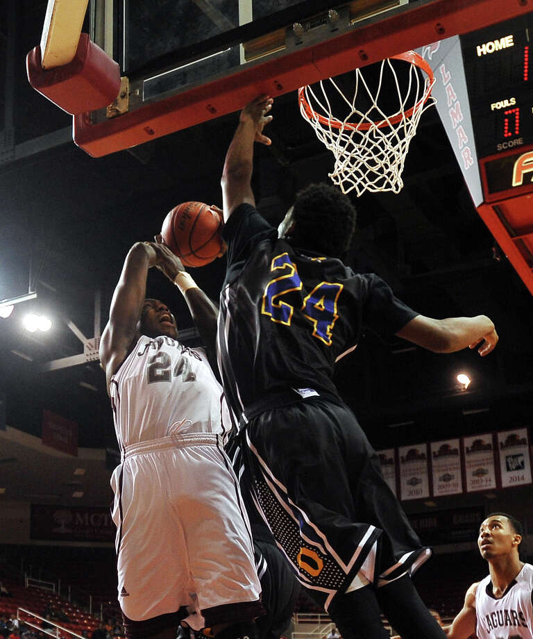 Central's E'Torrion Wilridge, No. 24, goes up for a basket as Ozen's Christian Bolton, No. 24, goes up to defend Saturday. The boys basketball teams from Ozen and Central went head to head at the Montagne Center in the championship game of the YMBL basketball tournament Saturday afternoon. Photo taken Saturday 12/6/14 Jake Daniels/The Enterprise Photo: Jake Daniels / ©2014 The Beaumont Enterprise/Jake Daniels