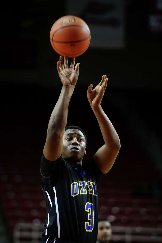 Ozen's Joshua Boyd, No. 3, shoots a free throw during Saturday's tournament final against Central. The boys basketball teams from Ozen and Central went head to head at the Montagne Center in the championship game of the YMBL basketball tournament Saturday afternoon. Photo taken Saturday 12/6/14 Jake Daniels/The Enterprise Photo: Jake Daniels / ©2014 The Beaumont Enterprise/Jake Daniels