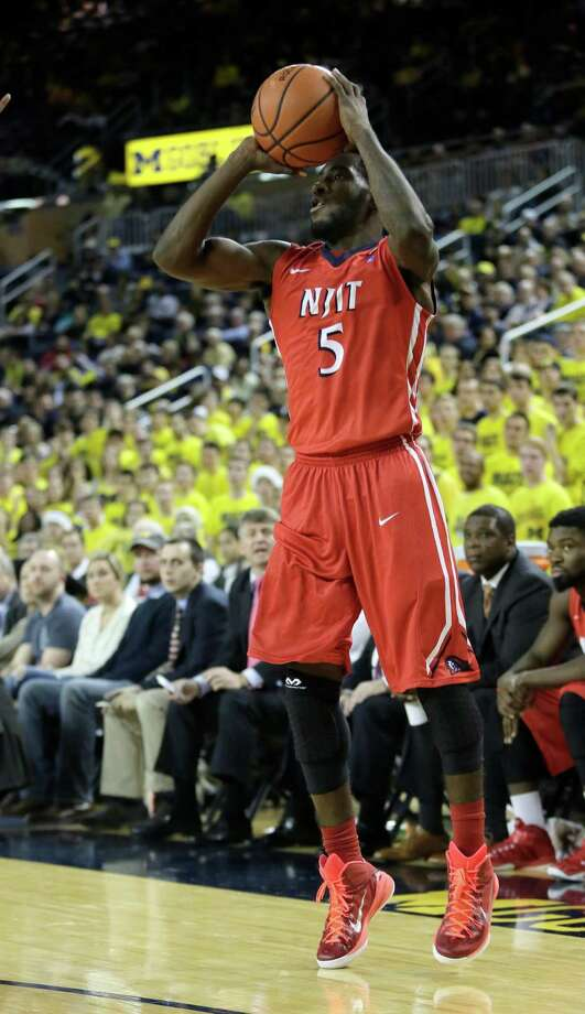 ANN ARBOR, MI - DECEMBER 6:  Damon Lynn #5 of the New Jersey Institute of Technology Highlanders makes a three-point shot to take a 68-64 lead over the Michigan Wolverines during the second half at Crisler Arena on December 6, 2014 in Ann Arbor, Michigan. New Jersey Tech defeated Michigan 72-70. (Photo by Duane Burleson/Getty Images) ORG XMIT: 521825383 Photo: Duane Burleson / 2014 Getty Images