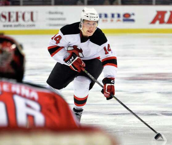 Albany Devils's #14 Reid Boucher scores against Portland Pirates' goalie Mike McKenna during Saturday's game at the Times Union Center Dec. 6, 2014, in Albany, NY.   (John Carl D'Annibale / Times Union) Photo: John Carl D'Annibale / 00029286E