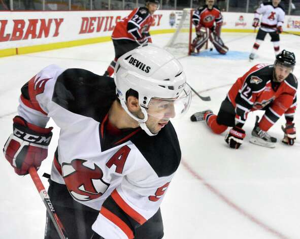 Albany Devils's #Joe Whitney, left, during Saturday's game at the Times Union Center Dec. 6, 2014, in Albany, NY.   (John Carl D'Annibale / Times Union) Photo: John Carl D'Annibale / 00029286E