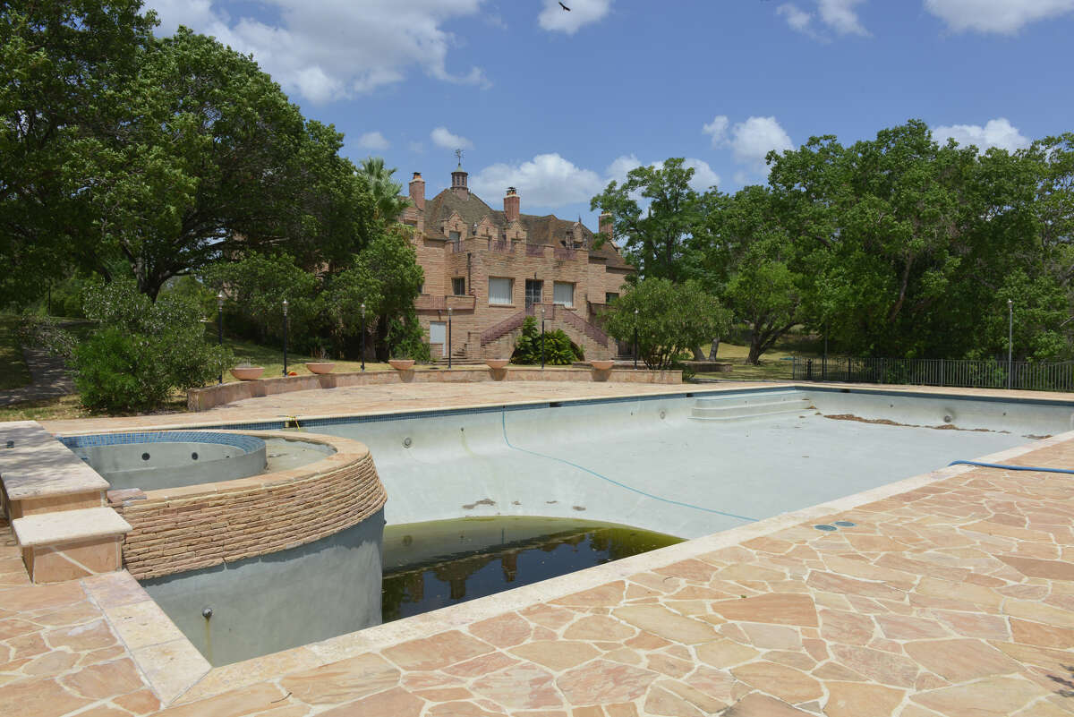 The empty pool of the Red Berry Mansion at 856 Gembler Rd. near the ATT Center is part of a redevelopment plan that calls for residential and commercial development.