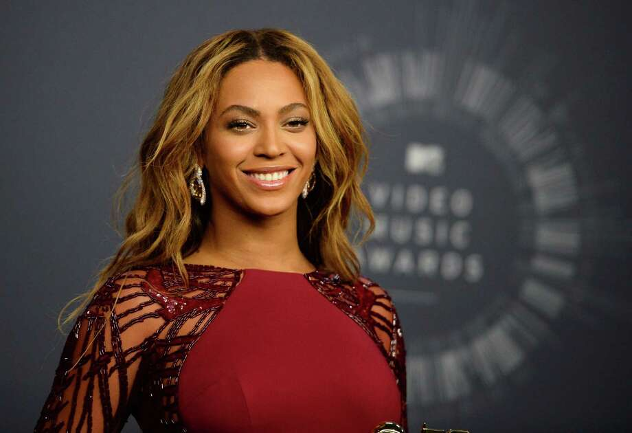 The increasing number of mixed-race people in the U.S., such as Beyonce, pictured here, may one day make racial issues less pressing. Photo: Jordan Strauss / Jordan Strauss / Associated Press / Invision