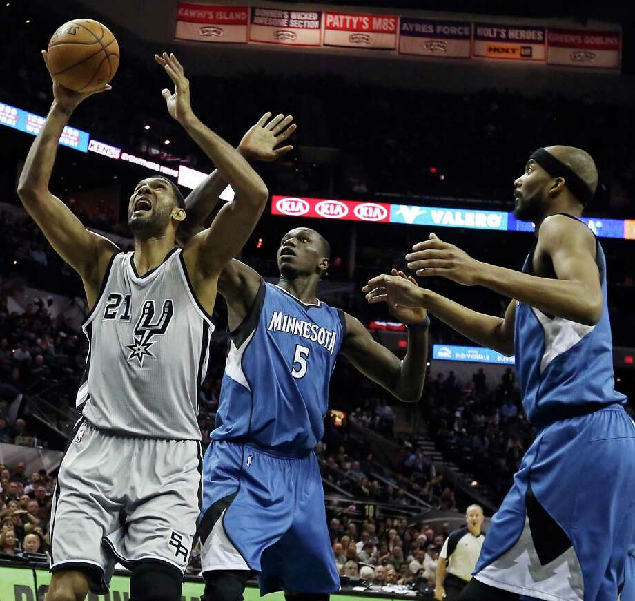 San Antonio Spurs' Tim Duncan grabs for a rebound against Minnesota Timberwolves' Gorgui Dieng (left) and Corey Brewer during first half action Saturday Dec. 6, 2014 at the AT&T Center. Photo: Edward A. Ornelas, Staff / San Antonio Express-News / © 2014 San Antonio Express-News
