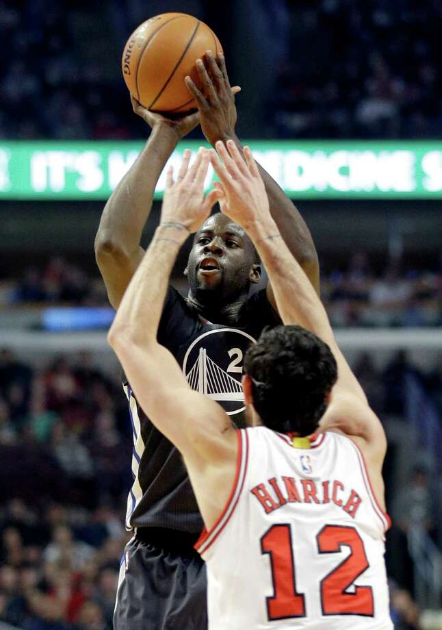 Golden State Warriors forward Draymond Green (23) shoots over Chicago Bulls guard Kirk Hinrich (12) during the first half of an NBA basketball game in Chicago on Saturday, Dec. 6, 2014. (AP Photo/Nam Y. Huh) ORG XMIT: CXA103 Photo: Nam Y. Huh / AP
