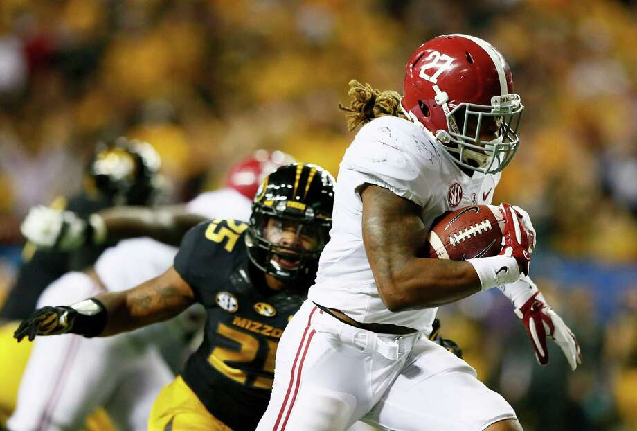 ATLANTA, GA - DECEMBER 06:  Derrick Henry #27 of the Alabama Crimson Tide rushes for a touchdown against the Missouri Tigers in the fourth quarter of the SEC Championship game at the Georgia Dome on December 6, 2014 in Atlanta, Georgia.  (Photo by Kevin C. Cox/Getty Images) ORG XMIT: 522466285 Photo: Kevin C. Cox / 2014 Getty Images