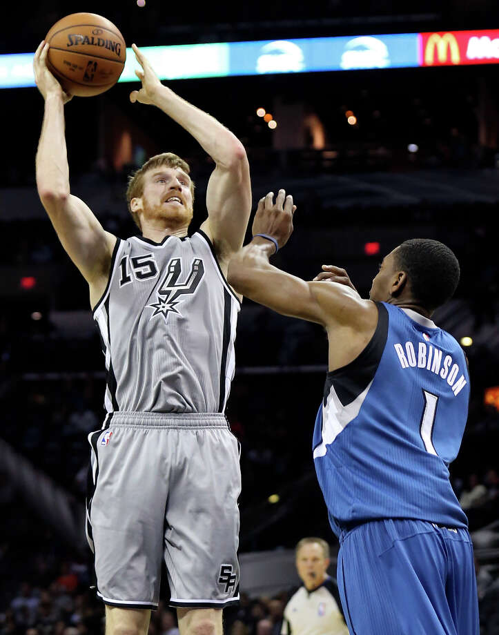 San Antonio Spurs' Matt Bonner shoots around Minnesota Timberwolves' Glenn Robinson during second half action Saturday Dec. 6, 2014 at the AT&T Center. The Spurs won 123-101. Photo: Edward A. Ornelas, Staff / San Antonio Express-News / © 2014 San Antonio Express-News