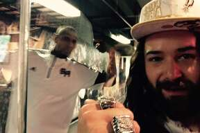 Fans take photos with Spurs Jesus at the AT&T Center on Saturday, Dec. 7, 2014.