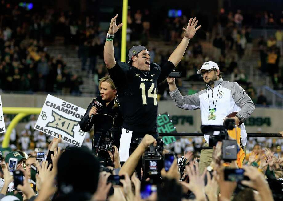 Quarterback Bryce Petty celebrates with Baylor teammates and fans following the Bears' win over Kansas State on Dec. 6, 2014 at McLane Stadium in Waco. The Bears clinched a share of the Big 12 title with the victory. Photo: Jamie Squire /Getty Images / 2014 Getty Images