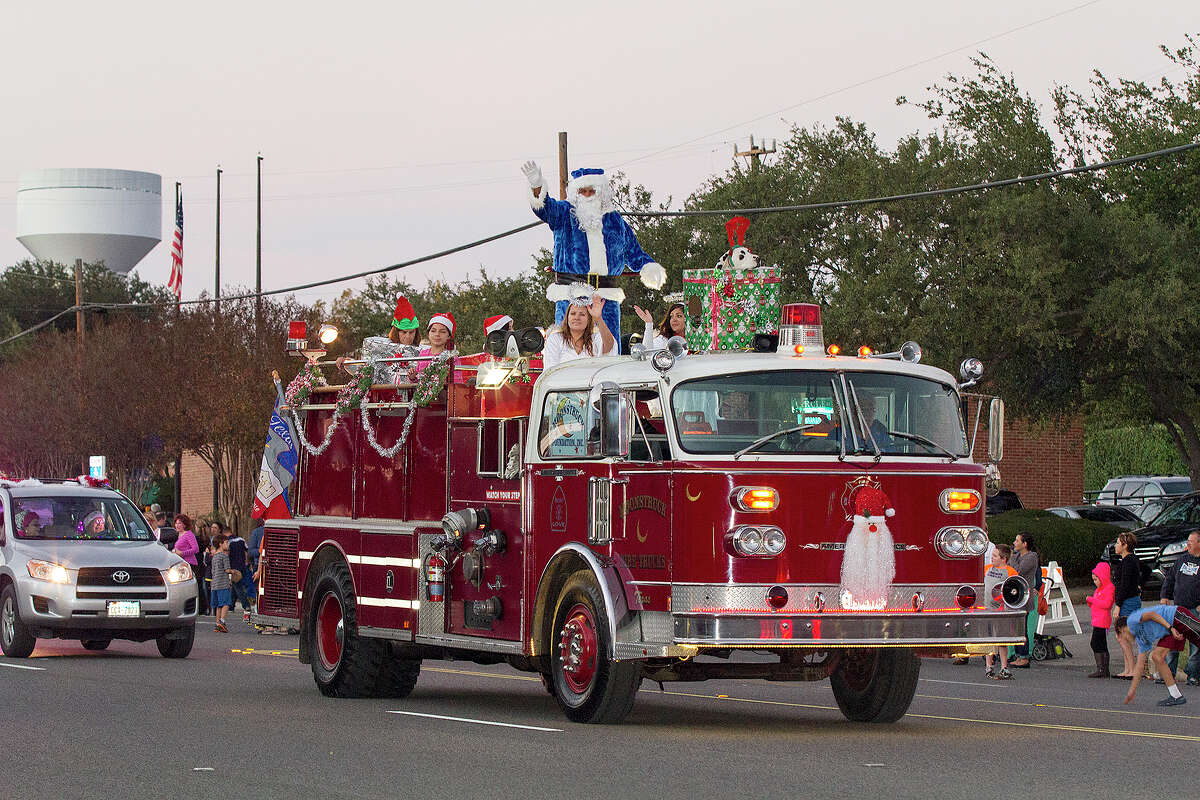 Santa rides in on a fire truck at the 37th annual Alamo Heights Holiday Parade on Broadway, Saturday, Dec. 6, 2014.