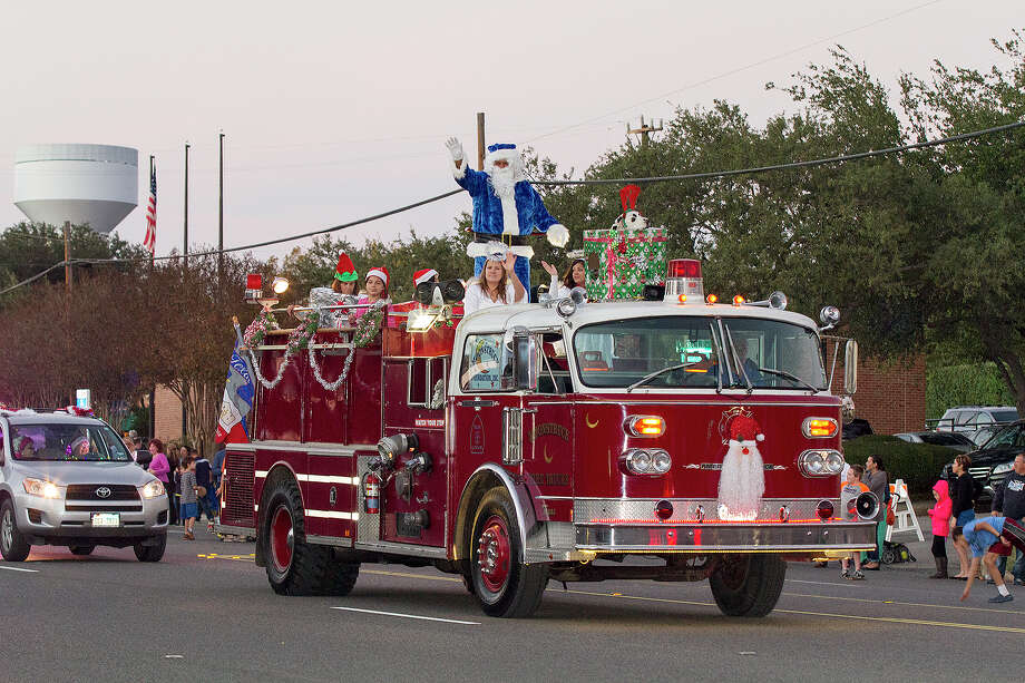 Santa rides in on a fire truck at the 37th annual Alamo Heights Holiday Parade on Broadway, Saturday, Dec. 6, 2014. Photo: Alma E. Hernandez, Alma E. Hernandez / For The San