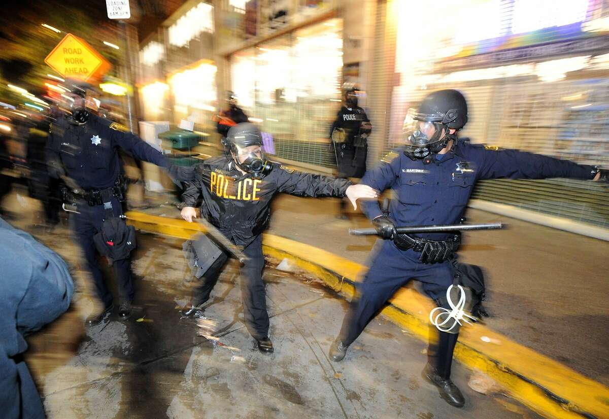 Berkeley police officers advance on a crowds during demonstrations in Berkeley, California on Saturday, December 6, 2014. Protesting continued through the night in response to the grand jury verdicts in the shooting death of Michael Brown in Ferguson, Missouri and the chokehold death of Eric Garner in New York City.