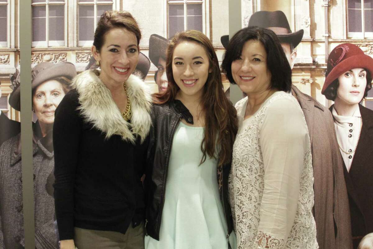 Valerie Segovia, Jacqueleen Segovia and Susan Garcia pose in front of the Downton Abbey Season 5 scenery before show time.