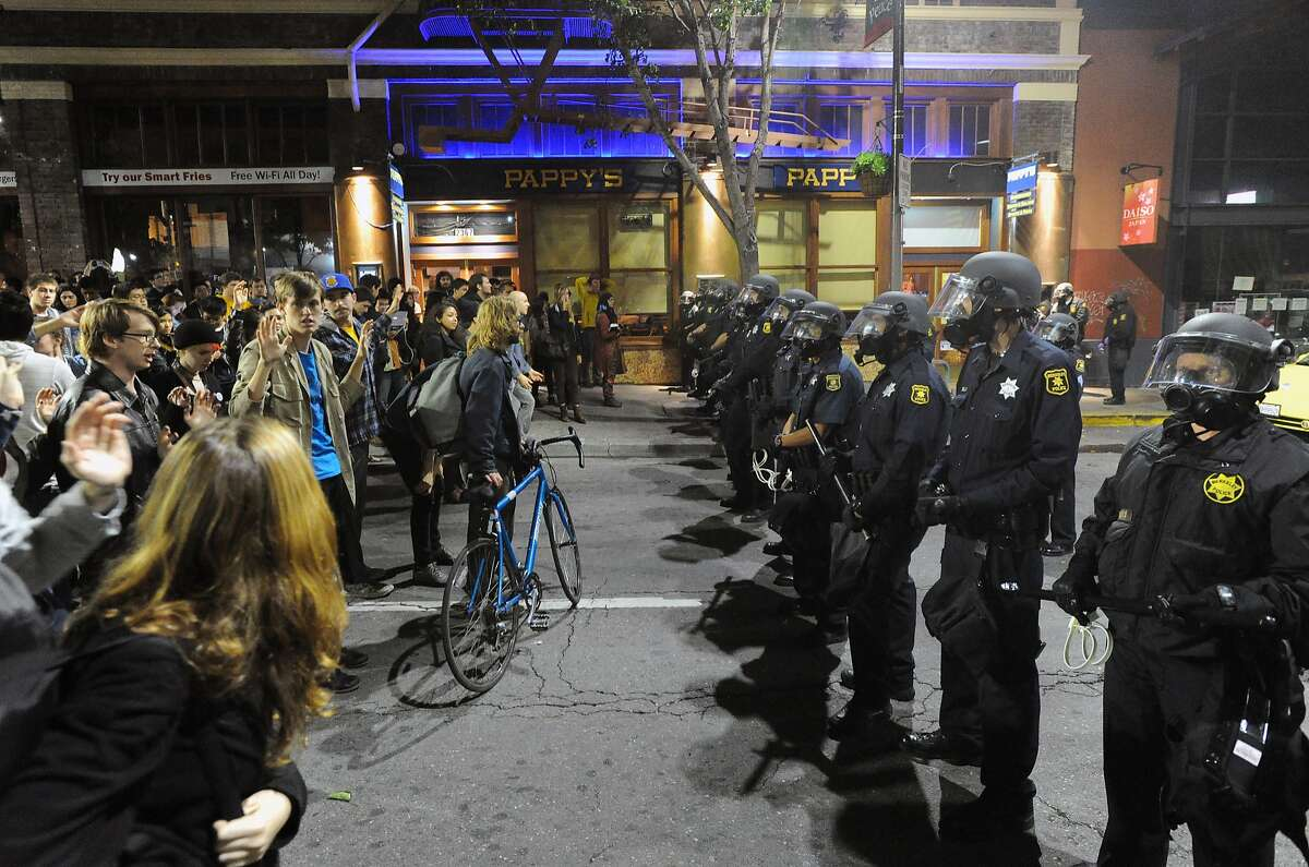 Police officers hold a skirmish line during demonstrations in Berkeley, California on Saturday, December 6, 2014. Protesting continued through the night in response to the grand jury verdicts in the shooting death of Michael Brown in Ferguson, Missouri and the chokehold death of Eric Garner in New York City.