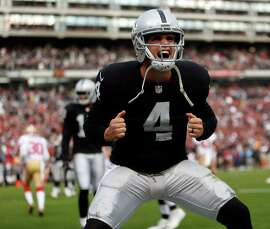 Oakland Raiders' Derek Carr celebrates 4th quarter touchdown by Mychal Rivera against San Francisco 49ers game at O.co Coliseum in Oakland, Calif., on Sunday, December 7, 2014.