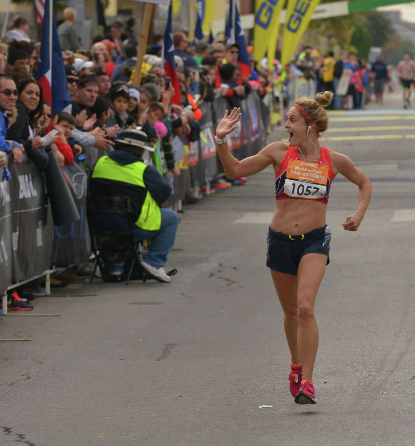 Lauren Smith acknowledges the crowd as she finishes 2nd in the womens division of the Rock N Roll Marathon Sunday.