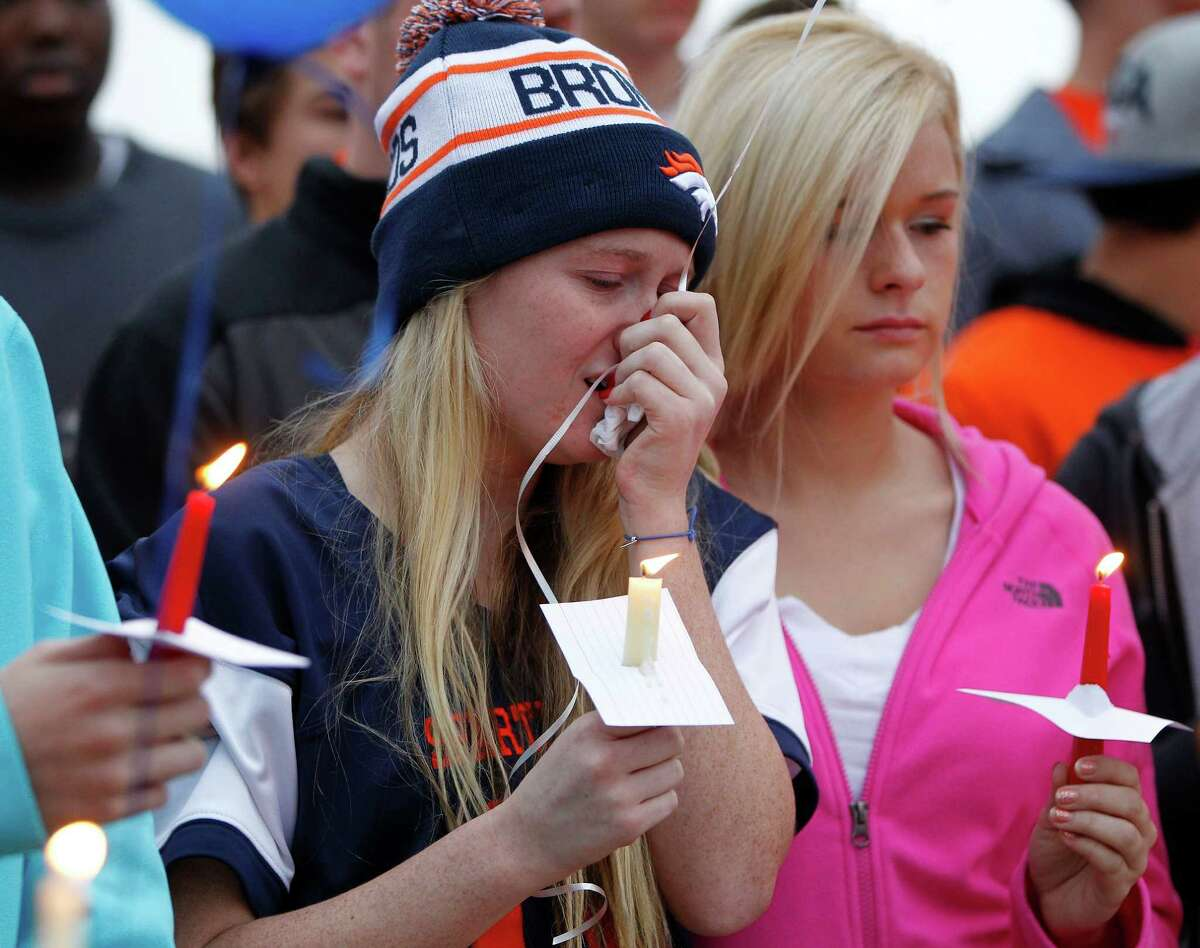 A girl reacts during a candle light vigil for Seven Lakes student Trent Weber, Sunday, Dec. 7, 2014, in Houston. Trent Weber, a 17-year-old senior at Seven Lakes, and Terra Kubala, a 16-year-old sophomore at Cinco Ranch, were killed early Sunday morning after a pick-up truck flipped over in Katy.