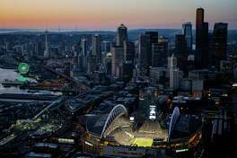 September 4 An aerial view shows the Seattle skyline and CenturyLink Field during the Seattle Seahawks season opener against the Green Bay Packers. The Seahawks won the game 36-16. National-level buzz surrounded the team after their first Super Bowl win earlier in the year.