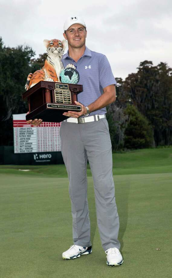Jordan Spieth holds the championship trophy after winning the Hero World Challenge golf tournament on Sunday, Dec. 7, 2014, in Windermere, Fla. (AP Photo/Willie J. Allen Jr.) ORG XMIT: FLWA114 Photo: Willie J. Allen, Jr. / FR170803 AP