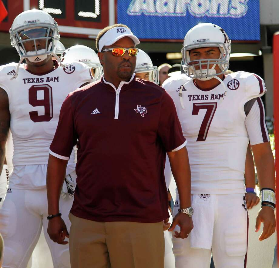 Texas A&M Aggies head coach Kevin Sumlin waits to take the field with his players during the start of a college football game at Bryant-Denny Stadium, Saturday, Oct. 18, 2014, in Tuscaloosa. Aggies lost the game 59-0. Photo: Karen Warren / Karen Warren / Houston Chronicle / © 2014 Houston Chronicle