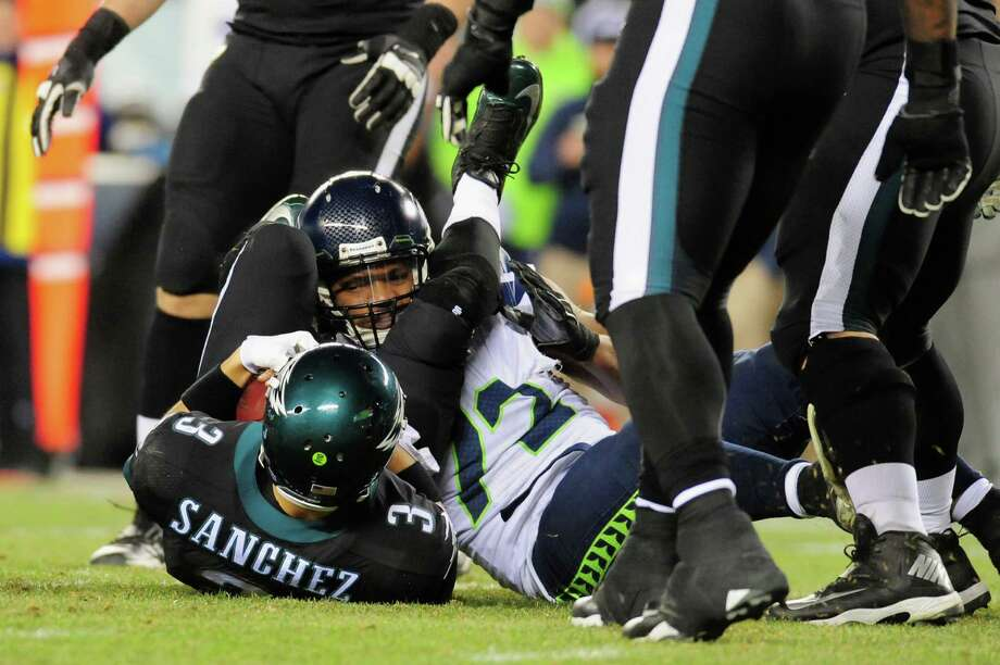PHILADELPHIA, PA - DECEMBER 07:  Michael Bennett #72 of the Seattle Seahawks sacks  Mark Sanchez #3 of the Philadelphia Eagles during the fourth quarter of the game at Lincoln Financial Field on December 7, 2014 in Philadelphia, Pennsylvania.  (Photo by Evan Habeeb/Getty Images) ORG XMIT: 507870613 Photo: Evan Habeeb / 2014 Getty Images