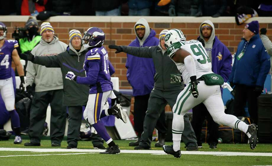 Minnesota Vikings wide receiver Jarius Wright, left, runs from New York Jets defensive end Sheldon Richardson during an 87-yard touchdown reception in overtime in an NFL football game, Sunday, Dec. 7, 2014, in Minneapolis. The Vikings won 30-24. (AP Photo/Alex Brandon) ORG XMIT: MNCN123 Photo: Alex Brandon / AP