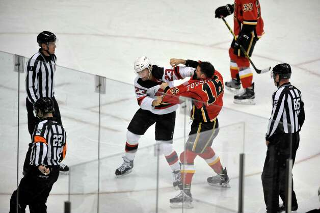 Darcy Zajac, left, of the Albany Devils and Mathieu Tousignant of the Adirondack Flames get into a fight during their game at the Times Union Center on Sunday, Dec. 7, 2014, in Albany, N.Y.  (Paul Buckowski / Times Union) Photo: Paul Buckowski / 00029286G