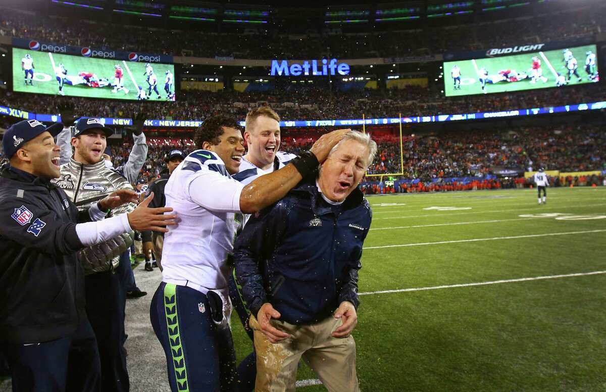 February 2 Seattle Seahawks quarterback Russell Wilson celebrates with coach Pete Carroll after Carroll had Gatorade dumped on his head in the final minutes during Super Bowl XLVIII at MetLife Stadium in New Jersey. The Seahawks dominated the Denver Broncos 42-8.