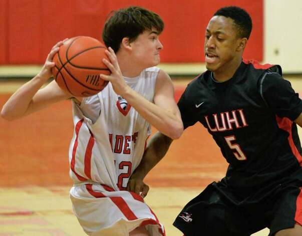 Albany Academy's #12  Rory Flaherty, left, and Long Island Lutheran's #5 Elijah Bailey during Saturday's game Jan. 11, 2014, in Albany, NY.  (John Carl D'Annibale / Times Union) Photo: John Carl D'Annibale / 00025309A