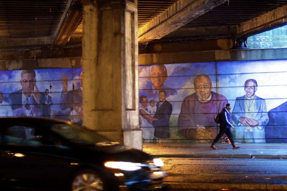 A mural on Broad Street in North Philadelphia depicts Bill Cosby in a purple sweater, a look reminiscent of his famous TV dad character, Dr. Cliff Huxtable. Photo: MARK MAKELA, STR / New York Times / NYTNS