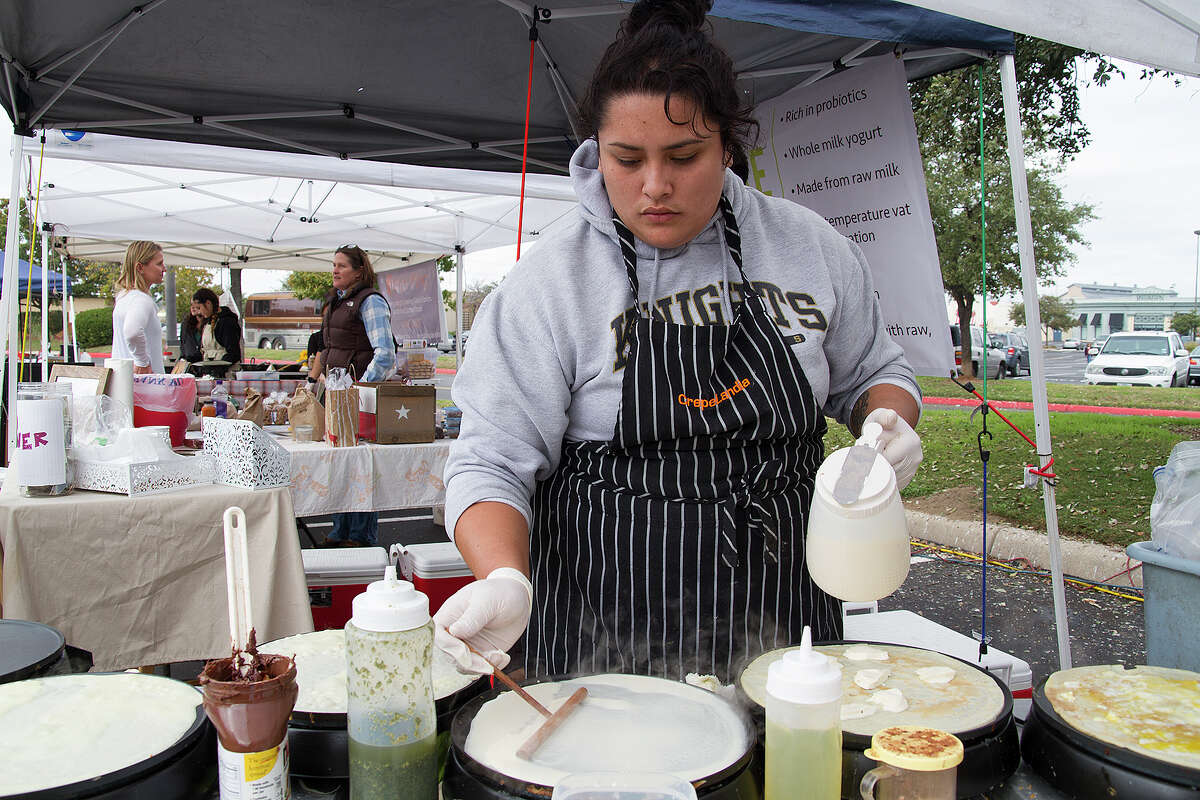 Marisa Cuellar prepares several crepes at CrepeLandia at the Alamo Quarry Farmers Market, the previous location for The Yard Farmers and Ranchers Market.