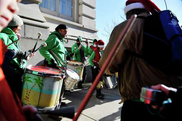 Members of the Troy Samba drum group perform on the street corner at the 32nd Annual Troy Victorian Stroll on Sunday, Dec. 7, 2014, in Troy, N.Y.  (Paul Buckowski / Times Union) Photo: Paul Buckowski / 00029717A