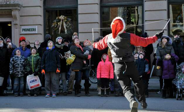 Spectators gaze skyward as the Incredible Larry (Larry Rundle) tosses an item high into the air as part of his juggling act as he performs at the 32nd Annual Troy Victorian Stroll on Sunday, Dec. 7, 2014, in Troy, N.Y.  (Paul Buckowski / Times Union) Photo: Paul Buckowski / 00029717A