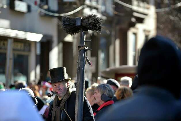 Stephen Piazza from Chatham is dresses as a chimney sweeper at the 32nd Annual Troy Victorian Stroll on Sunday, Dec. 7, 2014, in Troy, N.Y.  Piazza along with a group of friends dress in period clothing and sell Christmas wreaths with the money going to Joseph's House and Shelter in Troy.  (Paul Buckowski / Times Union) Photo: Paul Buckowski / 00029717A