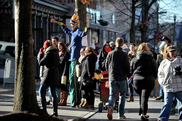 Seano the Circus Guy (Sean Fagan) poses on stilts for photographs with people attending the 32nd Annual Troy Victorian Stroll on Sunday, Dec. 7, 2014, in Troy, N.Y.  (Paul Buckowski / Times Union) Photo: Paul Buckowski / 00029717A
