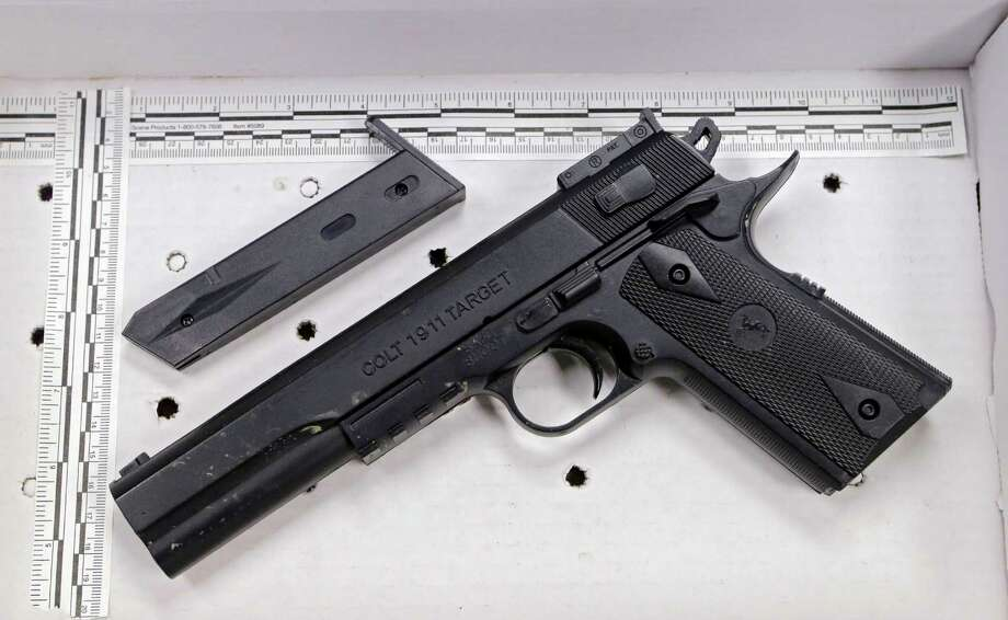 FILE- In a Wednesday, Nov. 26, 2014 file photo, a fake handgun taken from 12-year-old Tamir Rice, who was fatally shot by Cleveland police, is displayed after a news conference in Cleveland. The 12-year-old was shot at a city park  after he reportedly pulled the Colt 1911 replica on arriving officers. Two fatal police shootings in less than four months of young people holding lookalike guns in Ohio have raised calls for action to prevent such tragedies. (AP Photo/Mark Duncan, File) ORG XMIT: CD303 Photo: Mark Duncan / AP