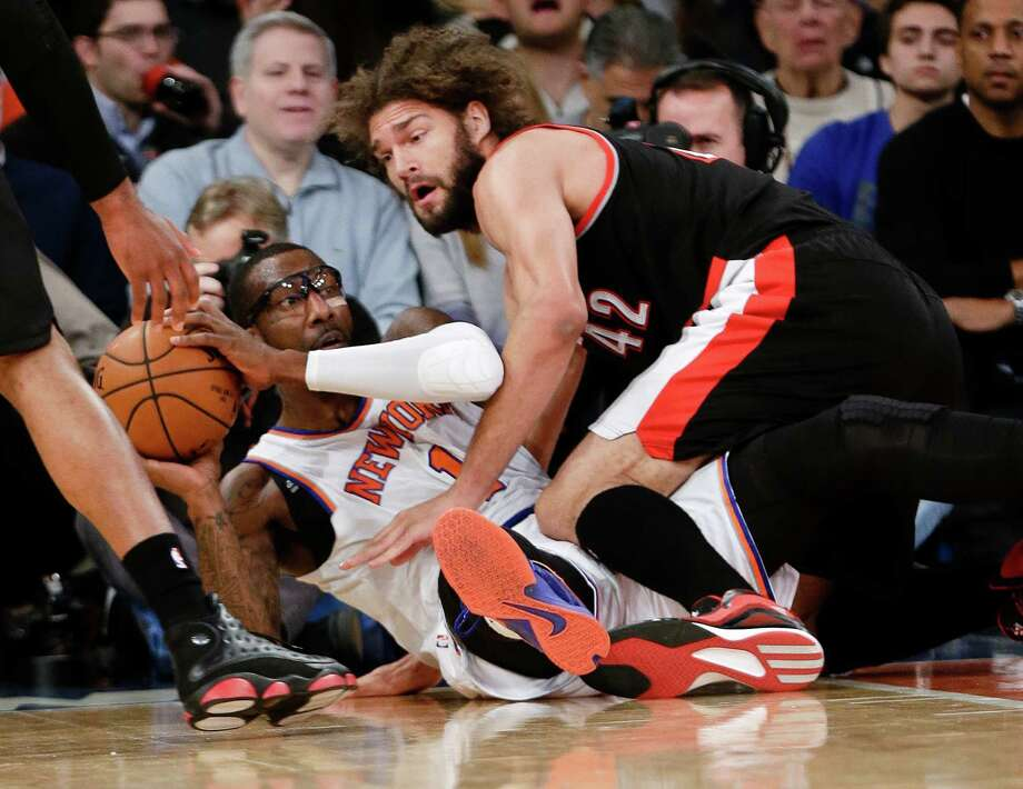 New York Knicks' Amar'e Stoudemire (1) and Portland Trail Blazers' Robin Lopez (42) fight for control of the ball during the first half of an NBA basketball game Sunday, Dec. 7, 2014, in New York.  (AP Photo/Frank Franklin II) ORG XMIT: MSG106 Photo: Frank Franklin II / AP