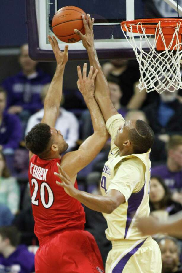 Washington center Robert Upshaw, right, blocks a shot by San Diego State forward JJ O'Brien (20) in the first half of an NCAA college basketball game, Sunday, Dec. 7, 2014, in Seattle, Wash. (AP Photo/Jennifer Buchanan) ORG XMIT: WAJB106 Photo: Jennifer Buchanan / ap
