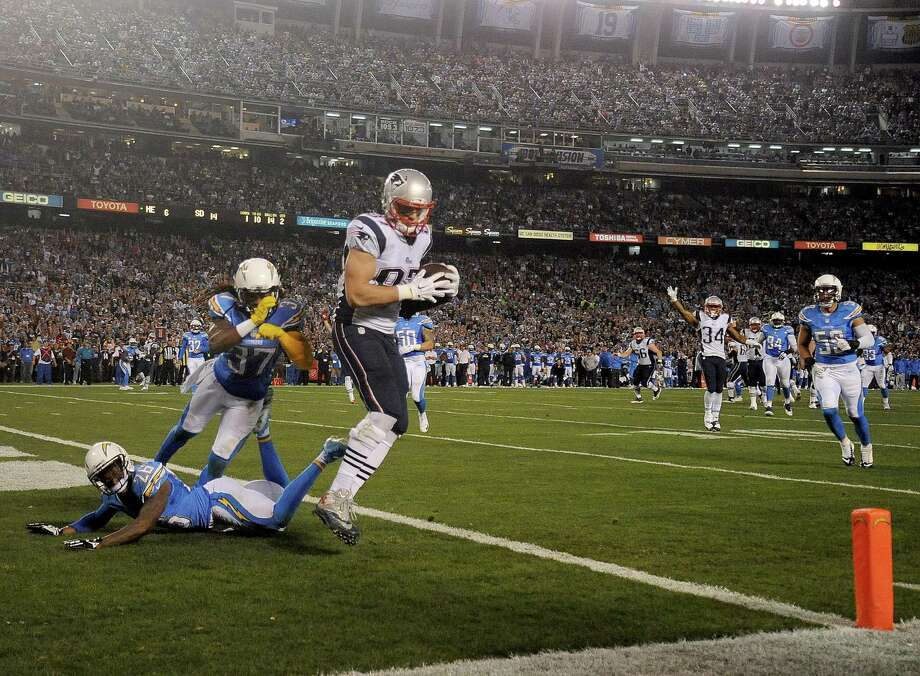 SAN DIEGO, CA-  DECEMBER 7:  Rob Gronkowski #87 of the New England Patriots catches a touchdown pass against the San Diego Chargers during their NFL Game at Qualcomm Stadium on December 7, 2014 in San Diego, California. (Photo by Donald Miralle/Getty Images) ORG XMIT: 507871949 Photo: Donald Miralle / Getty Images 2014
