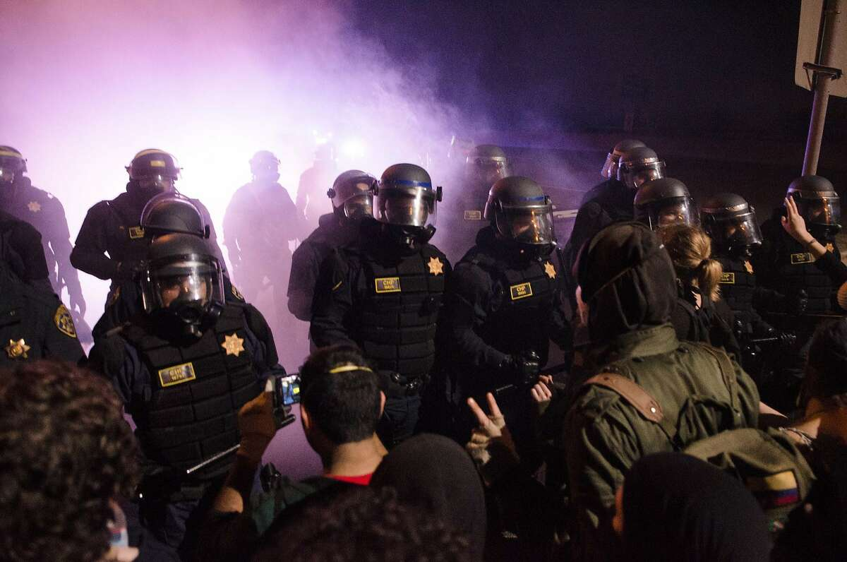 California Highway Patrol Officers push demonstrators off of an off-ramp to highway 24 on December 7, 2014 in Oakland, Calif. Protesters gathered to speak out against recent killings by police. Sean Havey, Special To The Chronicle