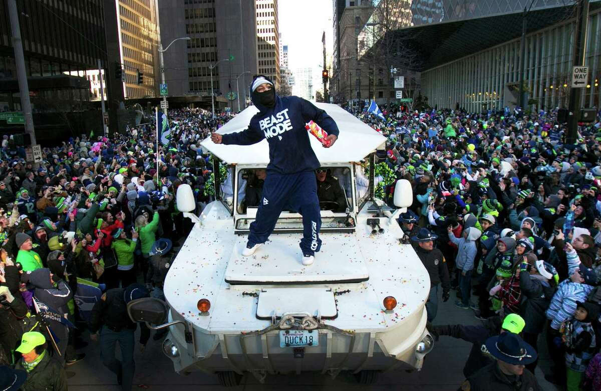 Feb. 5 - Marshawn Lynch throws Skittles back to the 12th Man and what was estimated to be a crowd of 700,000 people during the Super Bowl Championship Parade in downtown Seattle. The Seahawks' first Super Bowl win was a pivotal sports moment in the Pacific Northwest.