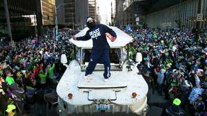 February 5  Ñ Marshawn Lynch throws Skittles back to the 12th Man and what was estimated to be a crowd of 700,000 people during the Super Bowl Championship Parade in downtown Seattle. The Seahawks' first Super Bowl win was a pivotal sports moment in the Pacific Northwest.
