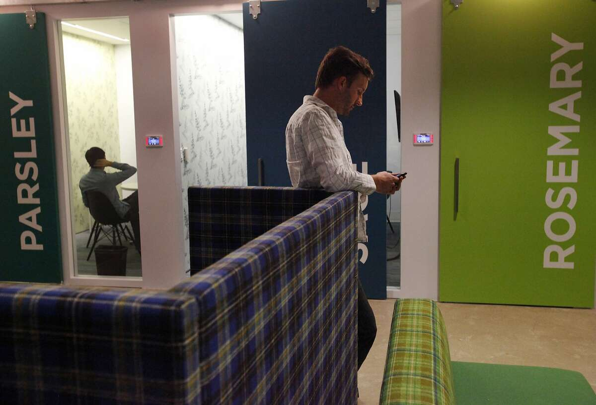 Dave Dueblin, 37, waits for a meeting in a themed room in the Pandora office Nov. 18, 2014 in Oakland, Calif.