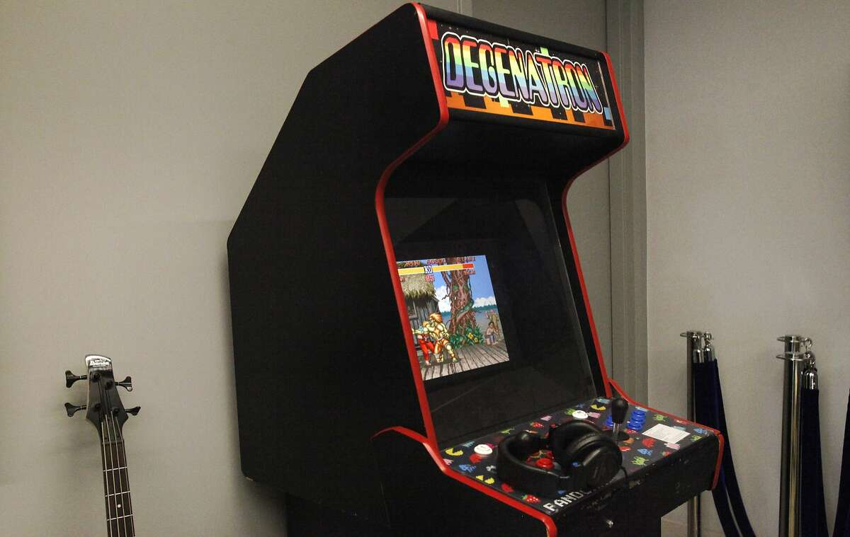 An arcade game sits in the corner with other miscellaneous gaming items in the Pandora office Nov. 18, 2014 in Oakland, Calif.