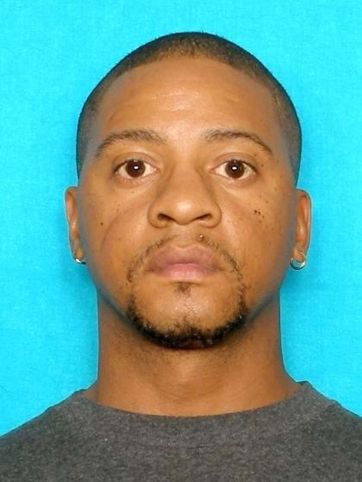 Christopher Bernard Doss, 41, is wanted on capital murder charges after gunning two people down Sunday on the West Side, according to police.