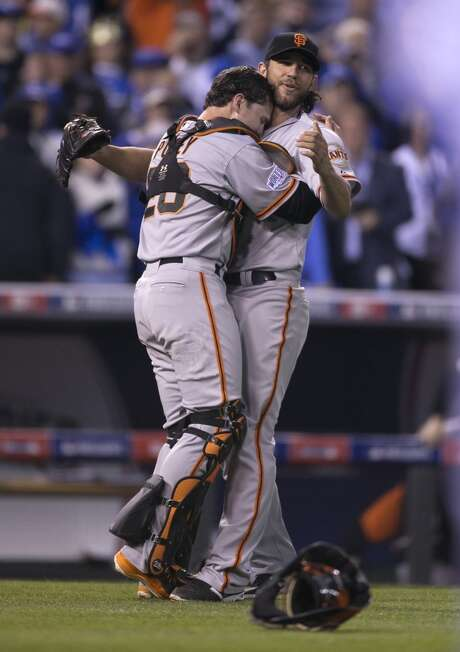Giants Buster Posey hugs Madison Bumgarner as the Giants defeated the Royals in Game 7 of the World Series at Kauffman Stadium on Wednesday, Oct. 29, 2014 in Kansas City, Mo. Photo: Scott Strazzante, The Chronicle