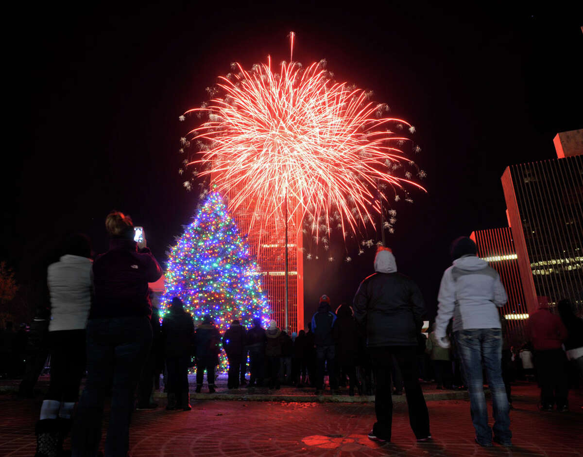 Fireworks explode in the sky during the tree lighting ceremony for the New York State tree at the Empire State Plaza on Sunday, Dec. 7, 2014, in Albany, N.Y. (Paul Buckowski / Times Union)