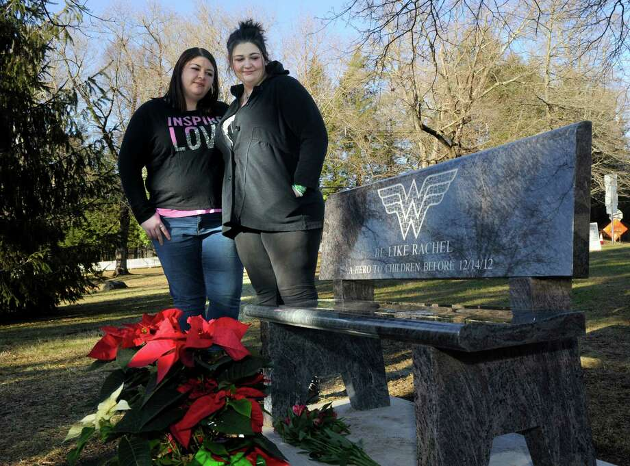 Sarah D'Avino, 27, left and Hannah D'Avino, 24, are the sisters of Sandy Hook Elementary School victim, Rachel D'Avino. The sisters are photographed with a bench dedicated to Rachel on the town green in Bethlehem, Conn., their home town, Sunday, Dec. 7, 2014. Photo: Carol Kaliff / The News-Times