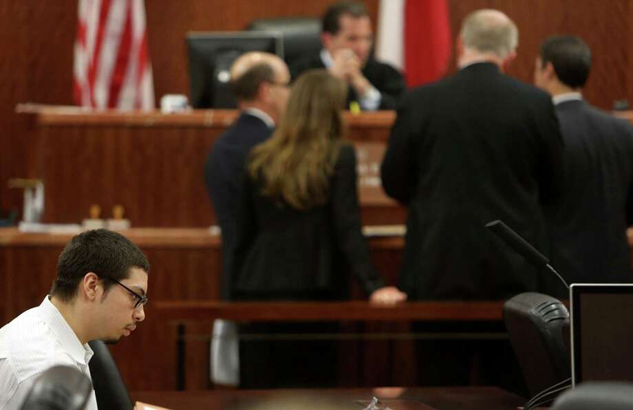 The council approaches the bench to begin opening statements in the capital murder trial of Jose Reyes, accused of killing Corriann Cervantes, begin today in the 338th State District Court at the Harris County Criminal Courthouse on Monday, Dec. 8, 2014, in Houston. Photo: Mayra Beltran, Houston Chronicle / © 2014 Houston Chronicle